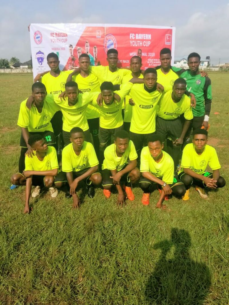 Photo shows players of Benin Warriors FC line up before one of their matches during the Bayern Munich trial program in Benin City.