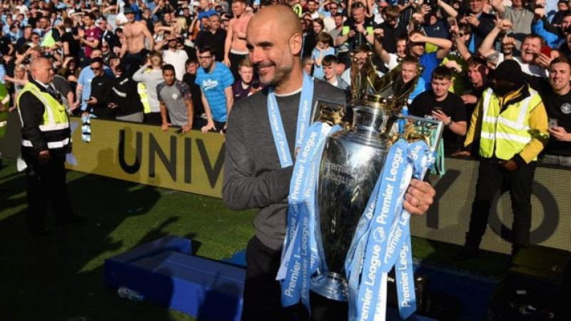 •Photo shows Manchester City manager Pep Guardiola with the Premier League trophy