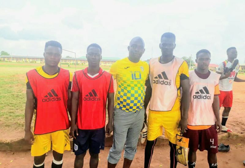 Photo shows Tayo Adeleke (middle),coach and of the Isaac Success Foundation, with some of the players.