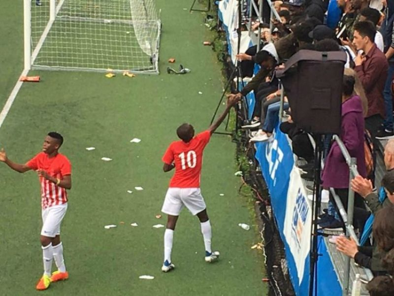 Photo shows Alhassan Yussif of Tiki Taka Nigeria acknowledging fans in the 2017 Gothia Cup in Sweden.